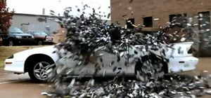 Watch a 1,500-Pound Box of Cell Phones Crush a Chevy Camaro