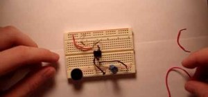 Wire up a 555 timer chip with a pulsing buzzer