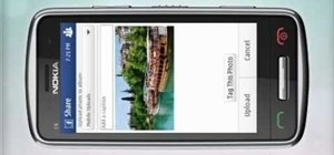 Upload pictures to Facebook on a Nokia C6-01 smartphone