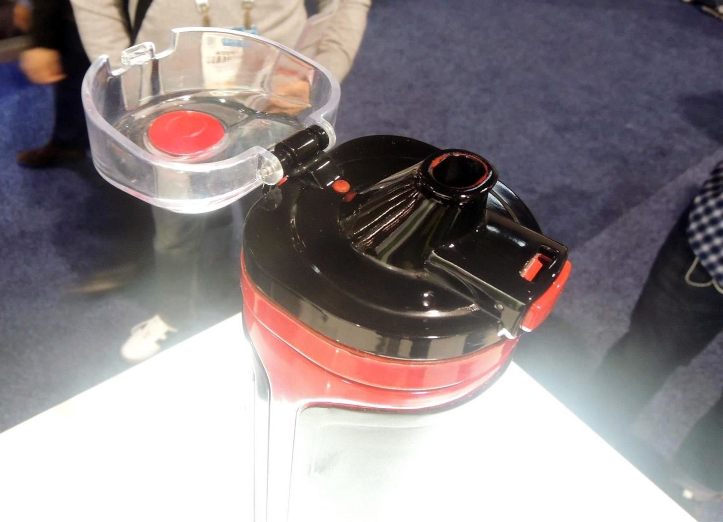 CES 2015: The Swiss Army Knife of Sports Bottles Plays Music & Holds Your Phone, Cash, Keys, & More