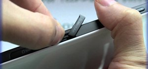 Insert a microSD memory card into the Samsung Galaxy Tab