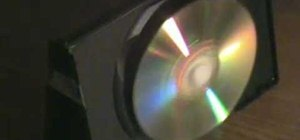Recycle old DVDs into cool light spinning disc with an electric motor