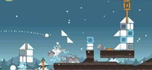 Beat level 12 of Angry Birds Seasons with three stars using only 2 birds