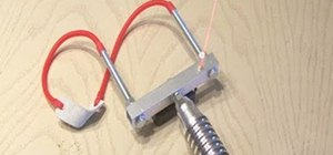 Make a heavy duty aluminum laser-guided slingshot