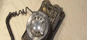 Build a ghost phone out of an old rotary phone and headphones