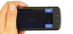 Turn on automatic software updates on a Nokia N97 smartphone